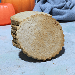 single Pumpkin spiced cookie leaning against a stack of cookies