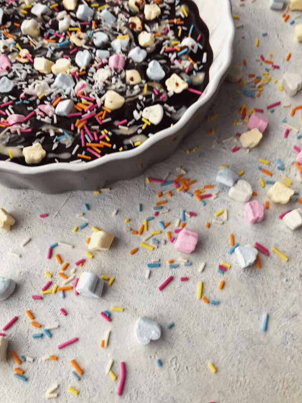 corner of bowl with chocolate bark and sprinkles