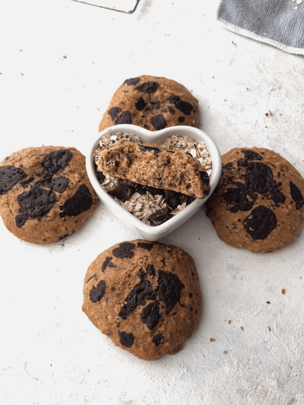 oatmeal cookies with heart shaped bowl of buckwheat flakes