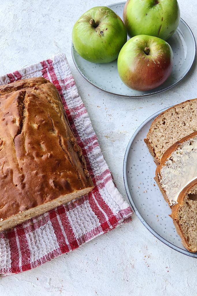 apple loaf with slices of loaf on plate