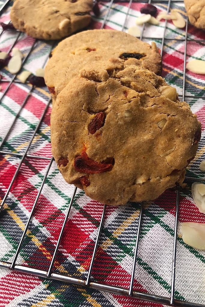 orange hazelnut cranberry cookies on a wire rack